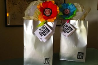 Poppies tied to gift bags