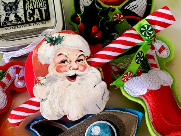 Santa Candy Cane Ornament