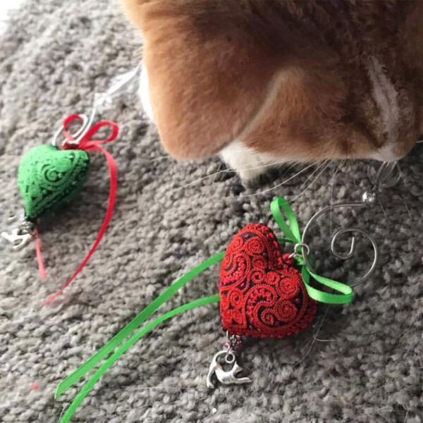 cat with heart ornament